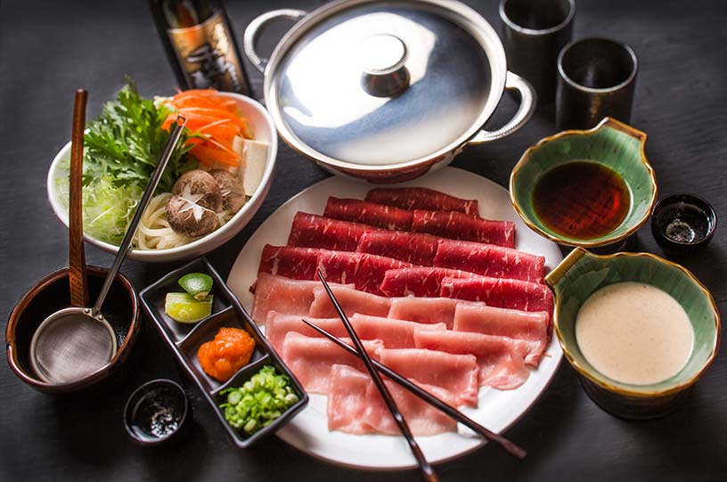 picture of full japanese food dinner with sashimi and miso soup
