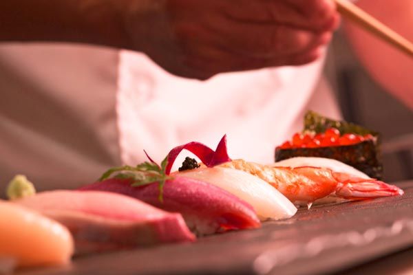 image of sushi being prepared by chef