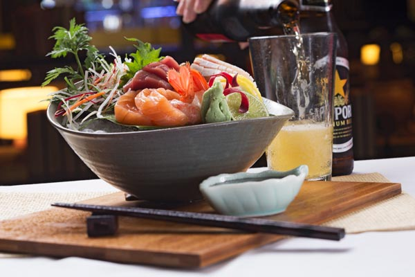 image of japanese food bowl with Sapporo beer
